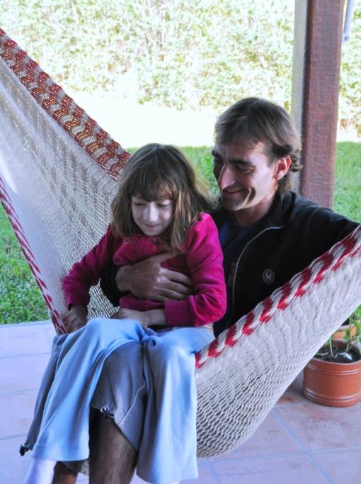 Horacio with Lila on the hammock
